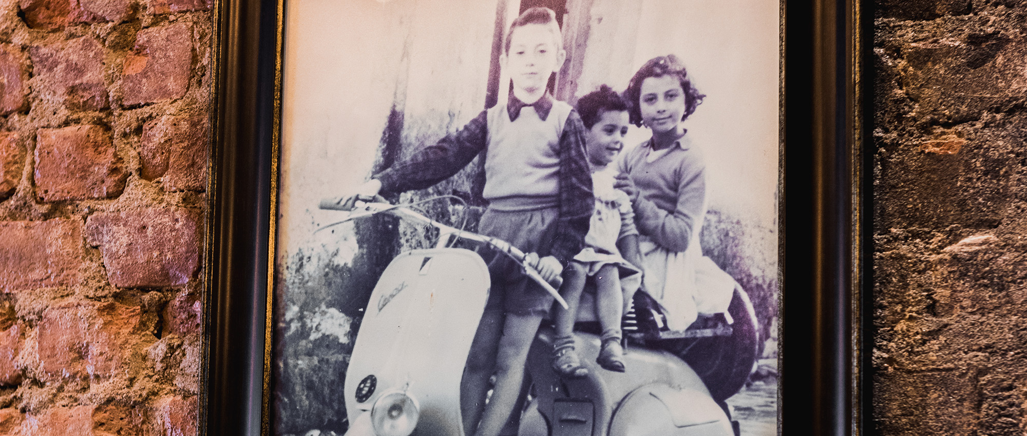 three children on a moped