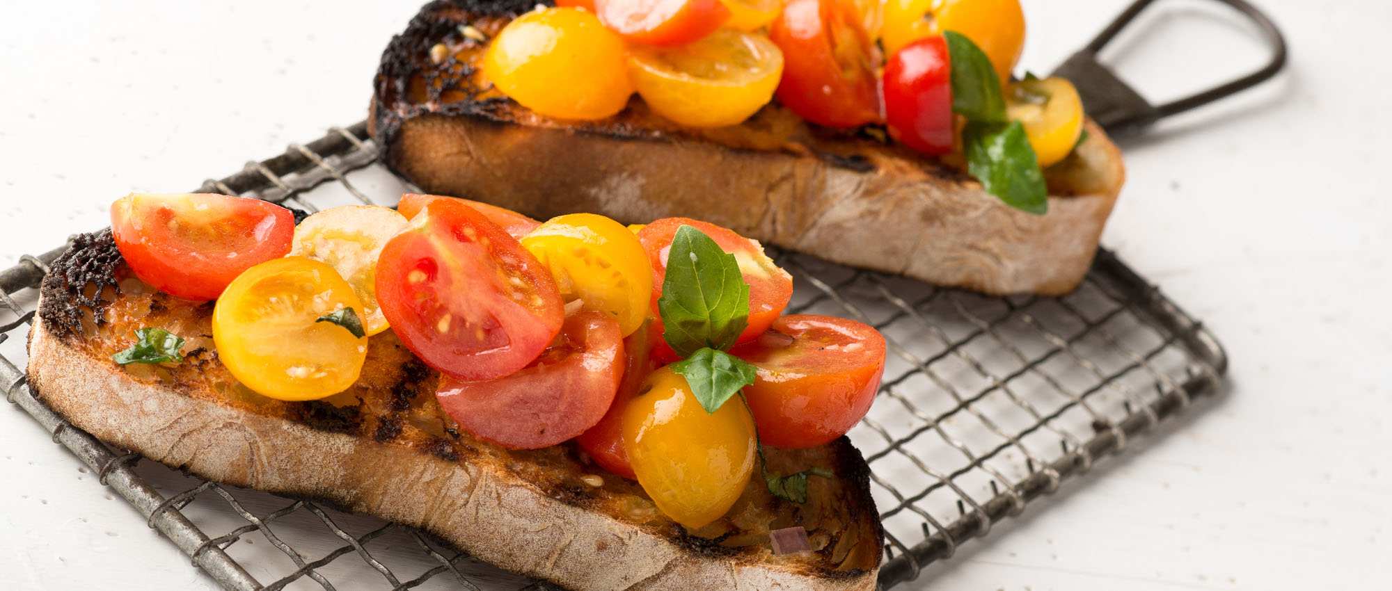 bread rubbed with garlic & olive oil, topped with fresh chopped tomato & basil