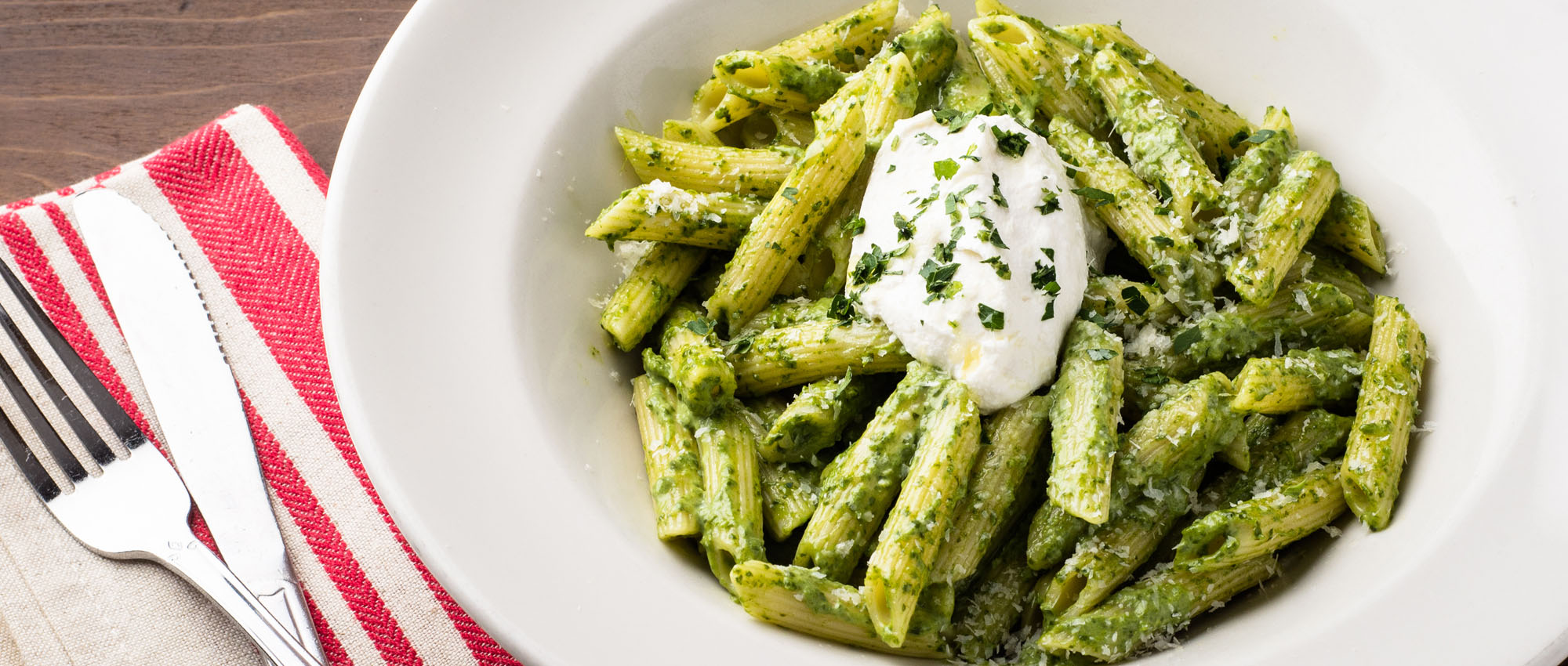 Penne pasta with spinach cream sauce and cheese