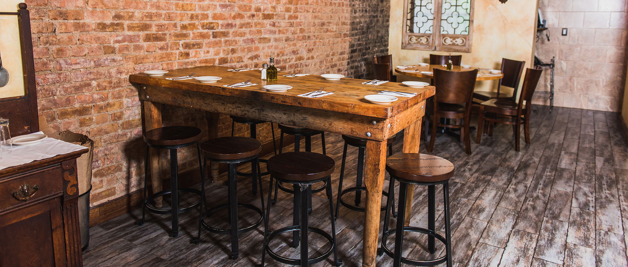rustic wooden high-top table with bar stools